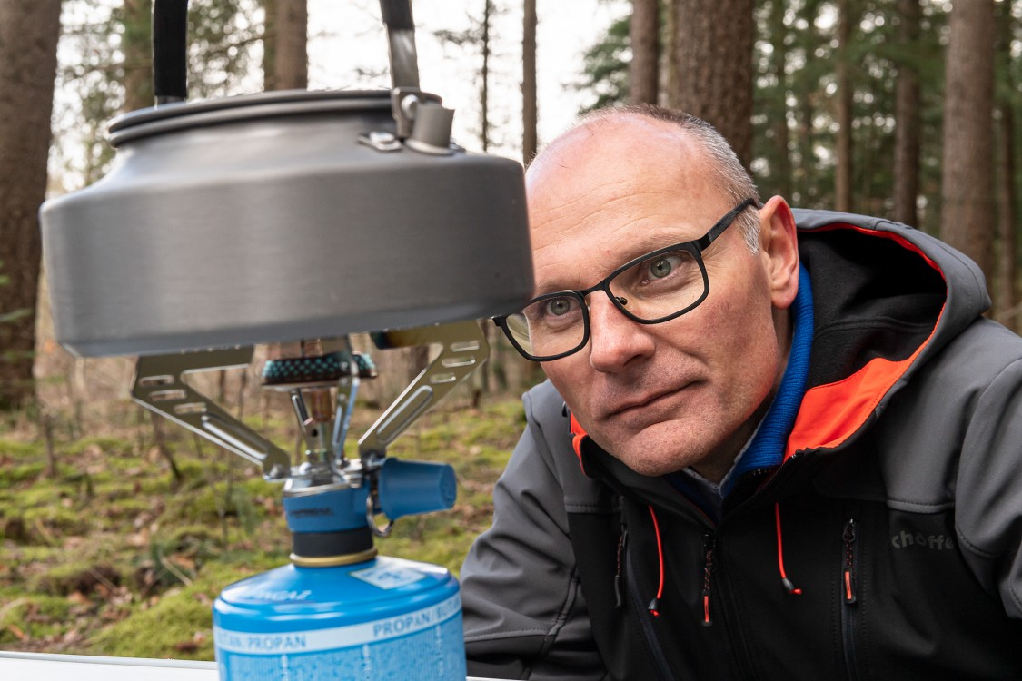 Wolfgang Klink, Business owner of Heat ReCycle, lights a propane-fired camping stove