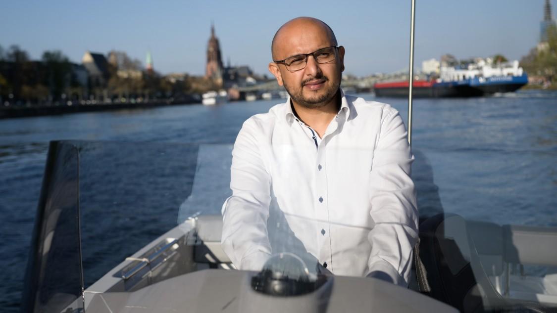 Business Owner Hamed Hossain on the river Main in Frankfurt