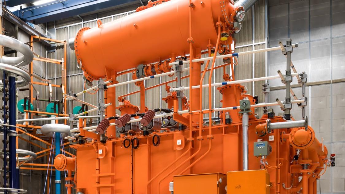 Photo of an orange Power Transformer