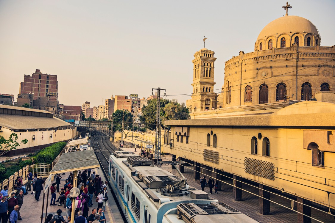 Cairo commuters at a train station near St George Church in the old city