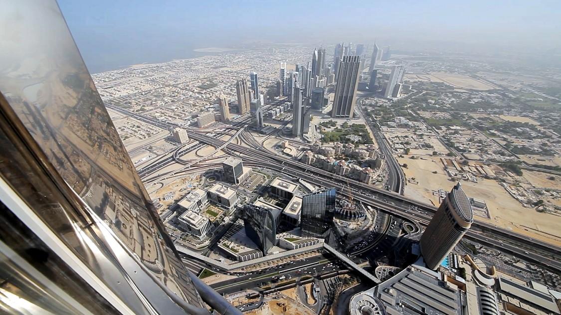 View on Dubai City from Burj Khalifa Tower in Downtown Dubai.