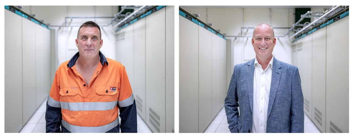 Joska Ferencz and Greg Mather inside the converter station at George Town
