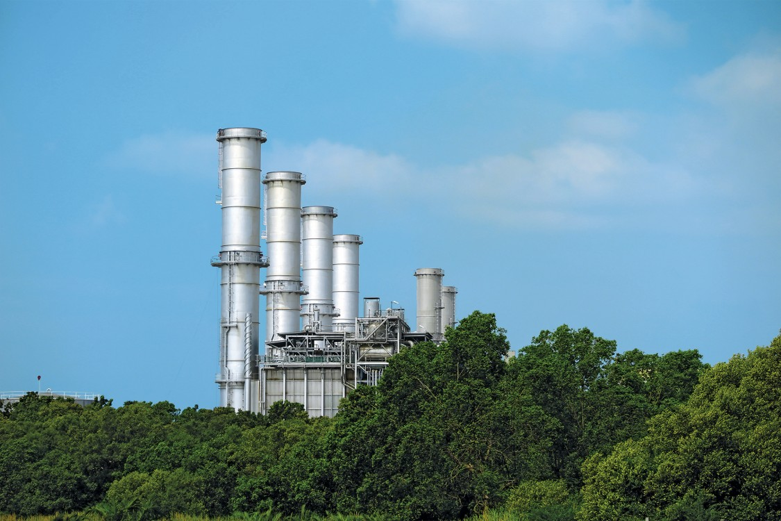 Stacks from the San Lorenzo and Santa Rita power plants located in the First Gen Clean Energy Complex, Batangas Bay, Philippines