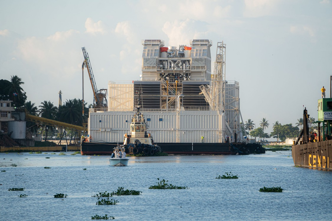 The power plant moving down the Ozama River.
